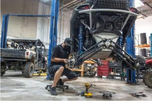 An ATV getting repaired by a professional