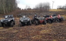 A wide variety of ATV's together on a terrain