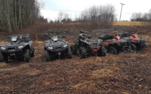 A variety of different ATVs together in a terrain expedition