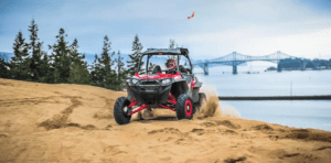 A coastline in Oregon where an ATV rider is enjoying in the sand dunes