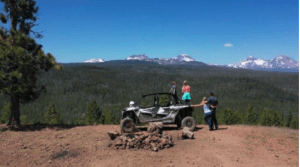 A family enjoying the view in a trail ride of Oregon