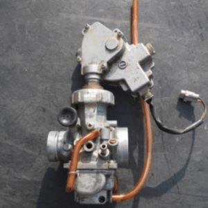 Image of a carburetor part being taken out for repair