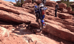 A dirtbiker facing a difficulty pull-up in the golden spike region.