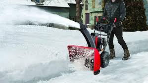 A snowblower performing the snow removal in two-stage process.