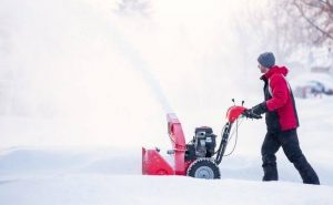 A two-stage snowblower working on dry snow.