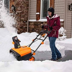 A tacklife snowblower in action.